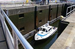 Police boat inside a canal at the Hiram Chittenden Locks in Seattle.jpg